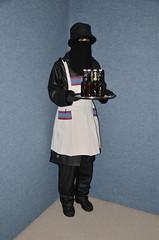 Slave Maid in Rainwear (Warm Clothes Fetish) Tags: slave maid sweat warm hot winter coat boots apron girl niqab hijab burka chador torture fleece fur hat rainwear