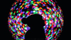 Christmas bubble (hispan.hun) Tags: projector projectorlens lens vintage bokeh bokehmonster bokehporn bokehmanipulation sonyphotography sony manual manualfocus christmas christmaslights christmasfair christmastree girl silhouette budapest hispansphotoblog night hispanhu hispan nightlights nightphotography hat
