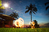 Top End Twirling (thecameramatt) Tags: longexposure darwin australia palmtree palm fire firetwirl firetwirling dusk