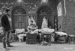 A street vendor selling cut sugar cane @ Loharee Gate, Lahore - Pakistan (LubnaJavaid) Tags: sugar cane cut sugarcane ganderian ganderi vender vendor cart lahoree gate lahore pakistan black blacknwhile blacknwhite blackandwhite loharee walled walledcity wall window streetlife desi local