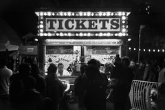 Let's get on a ride! (PeterThoeny) Tags: plazadecésarchávez plazadecesarchavez sanjose siliconvalley sanfranciscobay sanfranciscobayarea christmas christmasmarket tickets ticketbooth boxoffice light lights people monochrome blackandwhite sony sonya7 a7 a7ii a7mii alpha7mii ilce7m2 fullframe dreamlens vintagelens canon50mmf095 f095 canon 1xp raw photomatix hdr qualityhdr qualityhdrphotography fav100