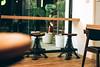 Eiffel or Tokyo? (andidrew) Tags: nikon f100 nikonf100 zeiss distagon t 35mm f2 35f2 35mmf2 zf2 agfa agfavista400 vista iso400 iso 400 cafe restaurant chairs indoor furniture taichung taiwan