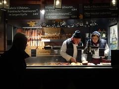 Vendor at German Christmas market (Briget Murphy) Tags: christkindlmarkt st wolfgang austria christmas market sausagees