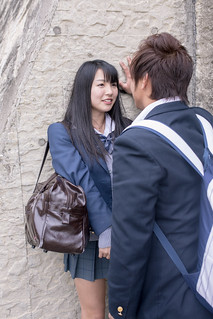 High school student couple closely looking at each other