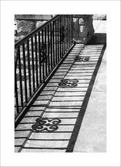 Shadows (DJ Wolfman) Tags: shadows blackandwhite bw fence sunlight art marlandmansion poncacity oklahoma architecture september olympus olympusomd em1markii zuiko 12100mmf4zuiko zd micro43