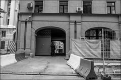 drd160605_0639 (dmitryzhkov) Tags: russia moscow documentary street life human monochrome reportage social public urban city photojournalism streetphotography people bw door gate fence enclosure tunnel corridor uniform servant dmitryryzhkov blackandwhite everyday candid stranger