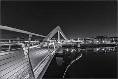 Squiggly Bridge Tradeston Glasgow_G5A5725B&W (ronniefleming@btinternet.com) Tags: bw blackandwhite squigglybridge glasgow scotland visitscotland ronnieflemingph31fy reflections riverclyde tradeston waterfront cityscapes leadinglines bridgingthegap mirror water