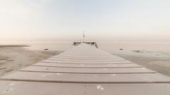 winter beach (andreasbrink) Tags: italy landscape winter lagomaggiore lisanza sky frost ice bridge beach lake morning