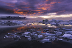 The Forever Moment (Iurie Belegurschi www.iceland-photo-tours.com) Tags: jokulsarlon glacier lagoon glassy guidedtoursiceland guidedtoursiniceland guidedphotographyworkshops guidedphotographytour sunset sunrise seascape water ice icy chunks iceland icelandphototours icelanders icelandic icelandphotographyworkshops icelandphotoworkshops icelandphotographytrip icelandiclandscape vatnajokull nationalpark glacial iuriebelegurschi iurie belegurschi icebergs iceberg freezing winter winterscape winterwonderland cold arctic mirror mirrorlike reflection blazing red pink forever moment snow wintery fineartlandscape fineart fineartphotography finearticeland fineartphotos