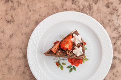 Piece of chocolate cheesecake with strawberries and whipped cream. (annick vanderschelden) Tags: cake cooking pressurecooking dessert chocolate eggs butter ookiecrumbs creamcheese sugar flour sourcream food cakeholder glass stand cakestand strawberries whippedcream grated sauce belgium