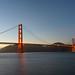Golden Gate Bridge lit up at dusk