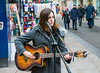 Busking on the streets of Oxford (stevebell) Tags: busker oxford oxfordcitycentre cornmarketstreet singer guitarist accousticguitar
