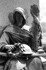 Until tomorrow, goodbye (radargeek) Tags: pa pennsylvania blackandwhite bw film statue x370s minolta masonicvillage elizabethtown veteransgrove helmet gun peace wreath cloak wwi