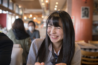 High school student girl smiling in cafe