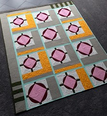 Stratagem Quilt (Quiltachusetts - Heather Black) Tags: modern contemporary quilt parcheesi quiltachusetts solid lap throw pink red orange khaki green aqua bella curve piecing circle square offset