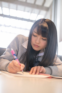 High school girl studying in restaurant