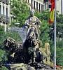 La Cibeles.   Madrid. (blanferblanc) Tags: fuente cibeles plaza bandera agua arbol ciudad edificio piedra leones diosa carro mastil