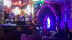 Singing club (Roving I) Tags: singers bands livemusic keyboards guitars decor flowers clubs newroyal coffeeshops entertainment danang vietnam