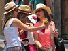 Tourist shopping (thomasgorman1) Tags: tourists people women canon street streetphotos streetshots smiling smiles outdoors candid public historic city mexico flowers hats