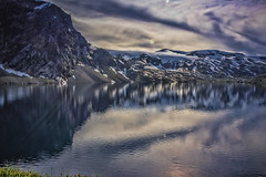 Djupvatnet (wimvandemeerendonk, back home) Tags: djupvatnet lake reflection snow mountains norway clouds cloud cloudscape glacier ice icefield landscape mountain mountainscape nature outdoors outdoor panorama rock rocks ripples sony sky sun wimvandem water ngc npc he look