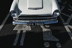 Run Down (NVOXVII) Tags: car parkingbay ironic comical observation street nikon boxingday ford cortina symbols runover road headlights frontgrill contrast