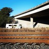 loss of habitat (rickele) Tags: abandoned motorhome rv winnebagocaterpillar freewayunderpass railroadtracks othersideofthetracks sacramento