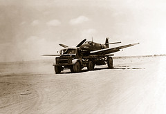 14 August 1942 - A British R.A.F. salvage crew transport a mostly intact Messerschmitt Bf.109F-4/trop from it's crash landing site next to the coast road, after it was forced down by AA fire behind the Australian Army lines near the rail station in El Ala (aussiejeff) Tags: leutnantmix gerhardmix elalamein 6jg27 yellow5 luftwaffe restored toned duotone uniform military british crash warbird bf109f4trop 1942 ww2 alamein wwii war fighter plane aircraft messerschmitt 109 desert egypt alamayn matrouh desertrats bw soldier army australia 217battalion nx22644 bandw blackandwhite blackwhite jeffc aussiejeff