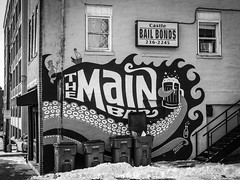 Bar & Bail (tim.perdue) Tags: downtown urban city columbus ohio olympus omd em10mkii mft micro four thirds tamron 14150mm main bar bail bonds wall mural graffiti street art sign window can garbage trash stairs snow parking lot sidewalk black white bw monochrome tentacles