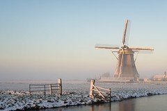 Winter landscape in the Netherlands with a windmill (altextravel) Tags: netherlands windmill landscape holland winter dutch snow fog mill rural kinderdijk sunrise nature traditional fence energy wind agriculture old architecture landmark foggy cold canal meadow ditch ice countryside tourism europe