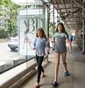 Ballet or Soccer? (UrbanphotoZ) Tags: girls teens busstop abt tights tutu sandals soccerball ballerina smile scaffolding sidewalk street median trees pedestrians upperwestside manhattan newyorkcity newyork nyc ny