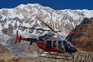 Helicopter flying in front of Annapurna I, Annapurna massif, Nepal