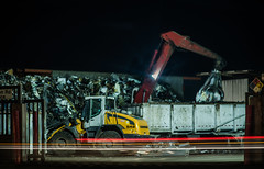 the red claw (pbo31) Tags: eastbay alamedacounty night december winter 2017 color dark black boury pbo31 nikon d810 bayarea oakland lightstream motion motionblur pick recycle claw picker truck mullfordgardens trash dump construction auto metal steel traffic roadway yellow tractor