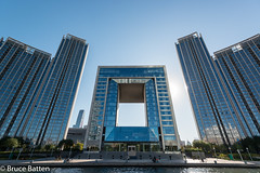 171029 Hai River, Tianjin-2.jpg (Bruce Batten) Tags: vehicles plants people reflections buildings businessresearchtrips china shadows locations trips occasions rivers urbanscenery tianjin bicycles trees subjects tianjinshi cn