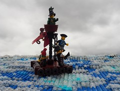The End of the White Doubloon (Robert4168/Garmadon) Tags: lego ship brethrenofthebrickseas eslandola mardier bobs micro telescope water sea ocean waves ripples stern raft sail minifigure blue yellow brown captainwhiffo captain story
