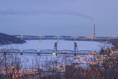 Old Stillwater and New St. Croix Crossing Bridges during Winter Twilight (Sam Wagner Photography) Tags: stillwater minnesota motion movement winter small midwest town mn wisconsin wi border st croix river blue hour twilight old new bridges crossing cold frozen long exposure xcel energy allen king power plant