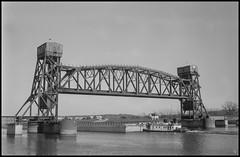 Right of Passage (argentography) Tags: train barge rail bridge river peoria illinois midwest kodak medalistii ilford hp5