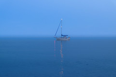 Sail on the Horizon (MrTheEdge7) Tags: nice france beach desolate boat sail sailboat eerie mist horizon endlesshorizon nowaves calm dawn