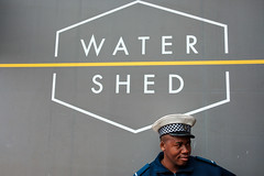 Water Shed (BrianEden) Tags: za watershed waterfront xpro2 harbor fujifilm man southafrica vawaterfront travel portrait fuji securityguard capetown candid travelphotographer travelphotography westerncape