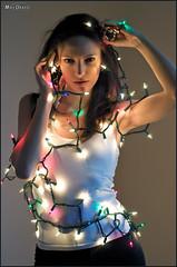 Nadine_9749 (newspaper_guy Mike Orazzi) Tags: nadine brunette ©mikeorazzi model lights merrychristmas christmaslights modeling d300 nikon portrait