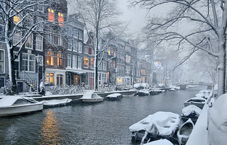 Snow falling silently in the early evening at the Egelantiersgracht in Amsterdam