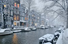 Snow falling silently in the early evening at the Egelantiersgracht in Amsterdam (B℮n) Tags: amsterdam snow covered bikes bycicles holland netherlands canals winter cold wester church jordaan street anne frank house dutch people gezellig snowy snowfall atmosphere colorful windows walk walking bike cozy light rembrandt corner water canal weather cool sunset celcius mokum pakhuis grachtengordel unesco world heritage sled sleding slee nowandthen bycicle 1°c sun shadows sneeuw brug slippery glad flakes handheld wind café denieuwelelie heineken anton pieck 50faves topf50 egelantiersgracht 100faves topf100 200faves topf200