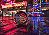 Lensball At Pike Place Market (Paul Scearce) Tags: seattle seattlewa pikeplacemarket citylights lights nightlights nightphotography lensball neonlights christmaslights puddlereflection reflections
