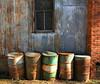 Barrels (pam's pics-) Tags: ks kansas us usa america barrels oketokansas rusty old pammorris pamspics picmonkey midwest abandoned hipsta hipstamatic iphone7 appleiphone wall bulding textures colors cameraphone mobilephonephotography smalltown