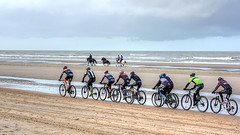 Speed is irrelevant if you are going in the wrong direction. Mahatma Gandhi (genevieve van doren) Tags: dehaan lecoq flanders westvlaanderen beach plage horses chevaux bicycles vélos sea mer sky ciel clouds nuages sand sable