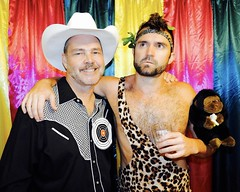 DSCN0149 (danimaniacs) Tags: beard scruff costume party colorful cap shirtless hat dennishensley smile curtain