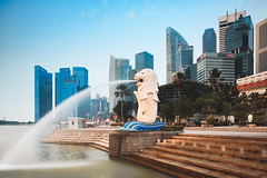 The Merlion statue fountain and the Singapore skyline. The landmark statue is considered the personification of Singapore. (Patrick Foto ;)) Tags: architecture asia asian attraction bay beautiful building business casino city cityscape corporate culture district downtown editorial famous fountain hotel landmark landscape light luxury marina modern office outdoors park place reflection river scene sculpture sea singapore sky skyline skyscraper statue sunset symbol theater tourism tourist tower travel urban view water waterfront sg