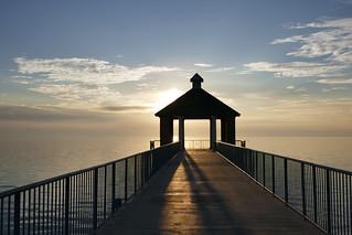 Sun setting over the pavilion on the lake