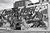 Escape into Action (Mister Day) Tags: mural building architecture publicart action cinderblock urban