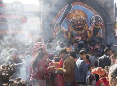 The offering (Tim Brown's Pictures) Tags: nepal kathmandu durbarsquare people temple statueofkalbhairava shiva bhairava godofdestruction protectoroftemple protectorofwomen protectoroftheweak blackgod religion faith