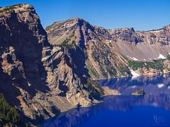 Crater Lake Summer Blue (RobertCross1 (off and on)) Tags: 40150mmf456mzuiko cascaderange cascades craterlake craterlakenationalpark em5 klamath omd or olympus oregon pacificnorthwest phantomship bluesky cliffs crater forest landscape mountain mountains nature rock snow trees volcanic volcano